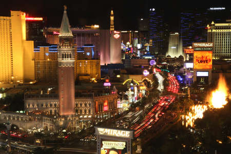 nightscene: Las Vegas, Neveada. USA. July 18th, 2011 - Image of the Las Vegas strip. Photographed at night. Rarely captured with the Mirage volcano and Bellagio fountain both active. Editorial