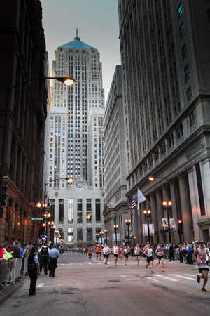 Chicago, Illinois. USA. October 9, 2011 -  Image of the Chicago Marathon athletes racing though the financial district in Chicago.