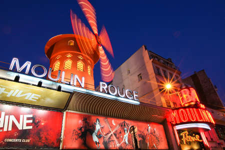 moulin: Paris, France. January 14, 2012 - Image of the famous Moulin Rouge at night.