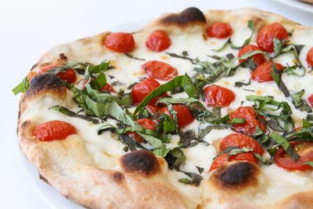 Tomato with fresh basil pizza