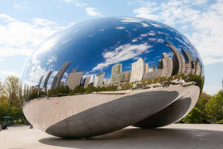 Chicago: Chicago, Il. USA - April 19, 2012: Image of the Chicago Bean in Millennium Park. The formal name of the art piece is Cloud Gate.