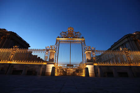 nightscene: Paris, France. January 15, 2012 - Image of the Palace of Versailles entryway at night. also known as Château de Versailles. Editorial