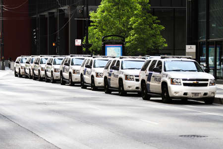 nato summit: Chicago, Illinois -  May 18, 2012: Image of Police SUV vehicles lined up along Chicago streets during the NATO summit. Editorial