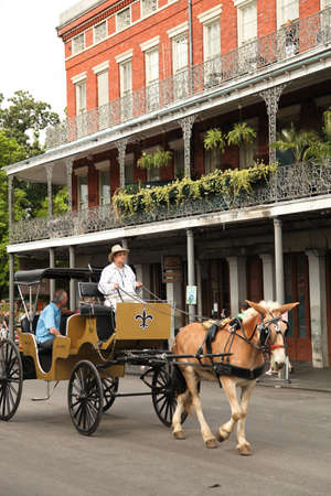 horse drawn carriage: New Orleans, USA - April 29,2012: Street scene of the French Quarter in New Orleans. Editorial