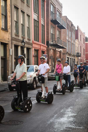 segway: New Orleans, USA - April 23, 2011: Image of tourist in French Quarter using Segways in New Orleans.