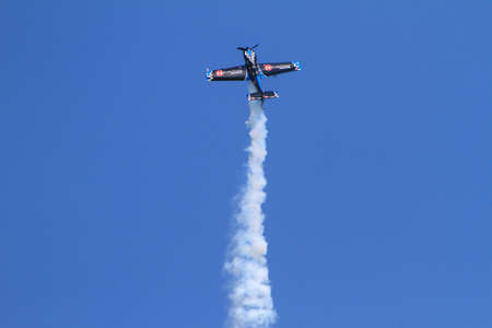 maneuver: Chicago, USA - August 19, 2012: Image of a Stunt plane performance at the Chicago Air and Water Show.