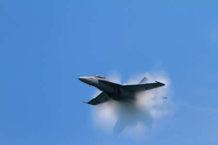 sonic: Chicago, USA - August 19, 2012: Image of a jet as it creates a Sonic Boom at the Chicago Air and Water Show. Editorial