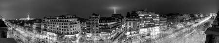Paris, France - January 18, 2012: Panoramic image of Paris at night. This image has the Eiffel Tower, Arc de Triomphe, and the ferris wheel at the Conord and the Grand Palace. Editorial
