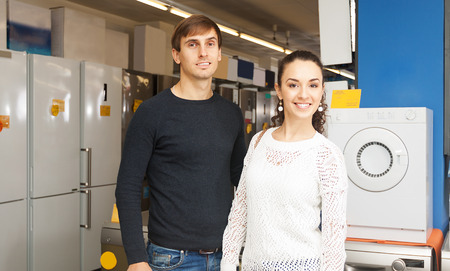 hobs: Portrait of ordinary family couple at household appliances store Stock Photo