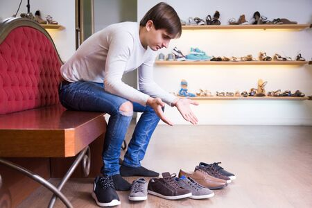 choise: Man need to make a choise about shoes