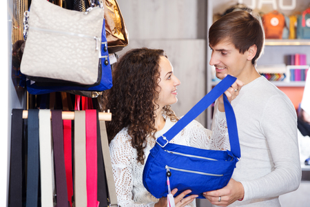 shopgirl: Positive smiling family in the bags shop