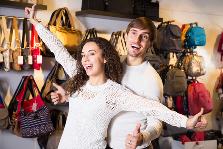 haberdashery: Young couple shopping in haberdashery shop and smiling