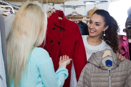 outwear: Ordinary women shopping winter outwear at the apparel store