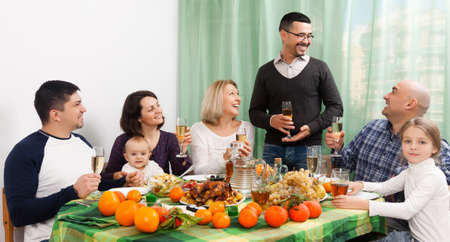 granny and grandad: Portrait of relatives celebrating happy family event in home Stock Photo