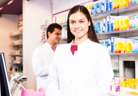 dispensary: Smiling woman pharmacist at the chemists shop
