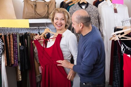 gladful: couple buys some dresses at shop