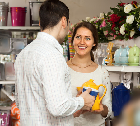 cookware: couple buying ceramic ceramic tableware in shop cookware Stock Photo