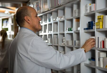 farmacy: Portrait of man pharmacists working in modern farmacy Stock Photo