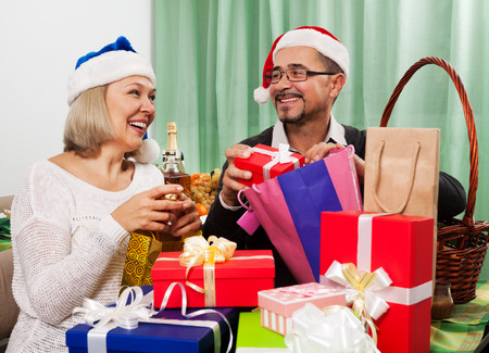 grandpapa: Adult persons preparing for celebrating Christmas at home