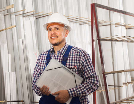 enginery: Positive foreman inspecting production output at factory