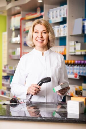 farmacy: Portrait of attentive female pharmacists working in modern farmacy Stock Photo