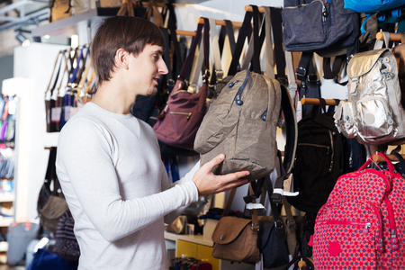 satchel: Handsome male customer purchasing new satchel in store Stock Photo