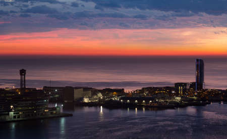 view of sunrise of Port Vell and La Barceloneta district. Barcelona, Spain