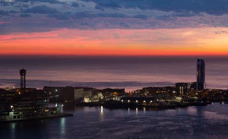 colom: view of sunrise of Port Vell and La Barceloneta district. Barcelona, Spain