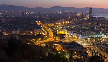 colom: panoramic view of Barcelona in evening. Catalonia, Spain