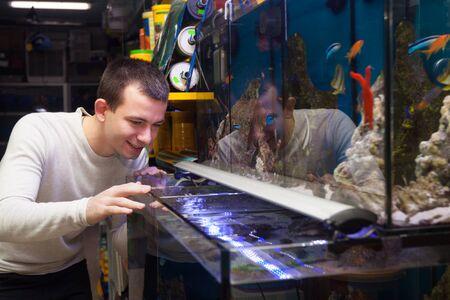 petshop: Ordinary customer buying tropical fish in in petshop Stock Photo