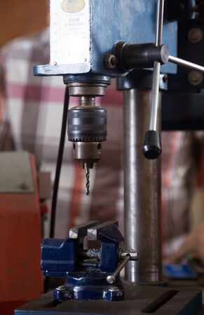 automated tooling: machine to drill holes in the workshop