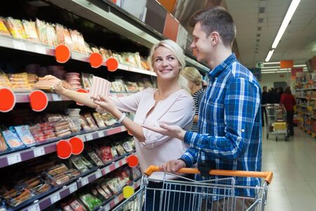 wurst: Young spouses purchasing in wurst section of supermarket