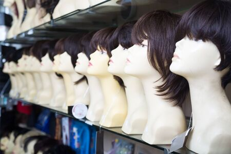 wigs: modern Mannequins with wigs on shelves of hair salon