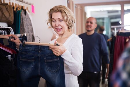 shoppingbag: Adult woman with a lot of clothes at the shop Stock Photo