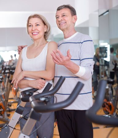 active adult community: mature couple posing in the gym. focus on man