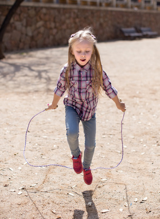 nice blond girl jumping rope