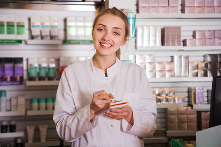 Portrait of  friendly specialist working in modern farmacy Stock Photo