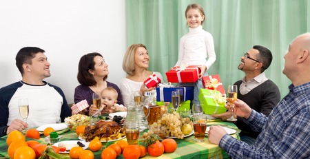 granny and grandad: Celebrating young girl birthday at festive table in home with smiling family