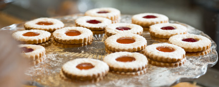 exquisite round cookies with jam in a crystal vase