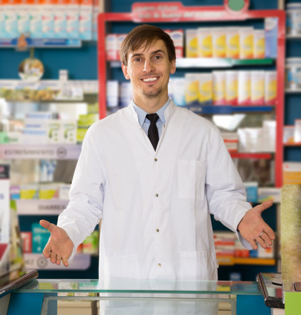 Portrait of young male pharmacists working in modern farmacy