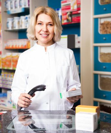 seniority: Portrait of blonde female pharmacists working in modern farmacy