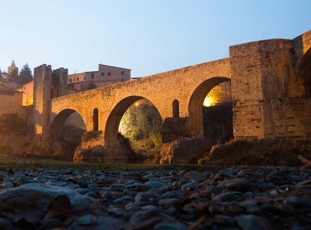 night view of medieval  bridge at Besalu. Catalonia, Spain Stock Photo