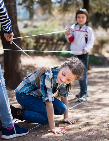 children games. active Girl gently goes through the tangled rope