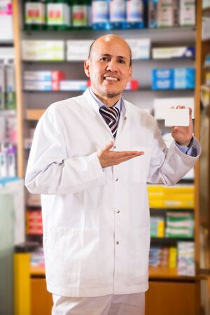 Portrait of  smiling male specialist working in modern farmacy