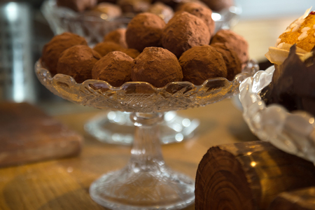 gourmet chocolate truffles in a crystal vase Stock Photo
