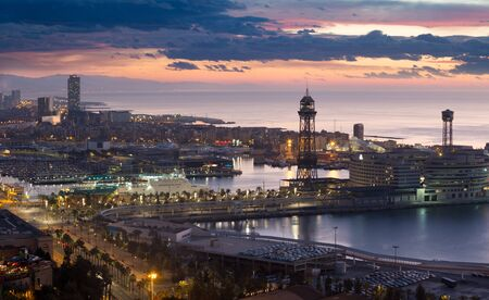 view of sunrise of Port Vell and La Barceloneta district. Barcelona, Spain Stock Photo