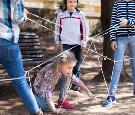 children games. active nice Girl goes through the tangled rope