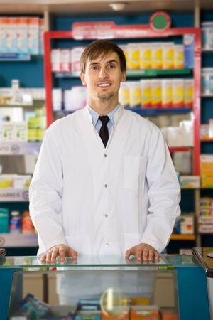 Portrait of affable male pharmacists working in modern farmacy