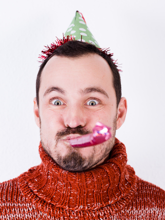 Portrait of Man on holiday in bell and whistle Stock Photo