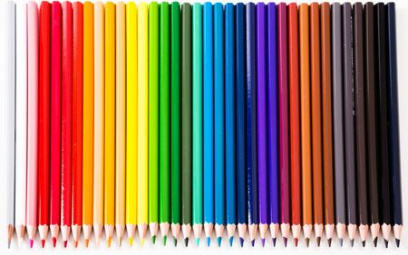 Colored pencils lying in row on white background Stock Photo